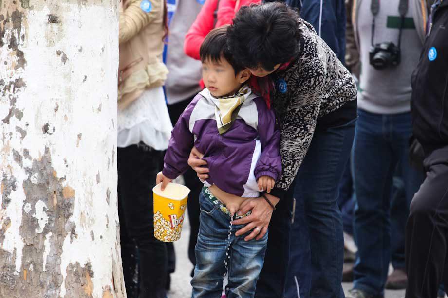 kid peeing in the street